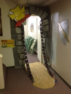 Drawbridge - picture only - appears to be a black paper chain, cardboard door and paper rocks.