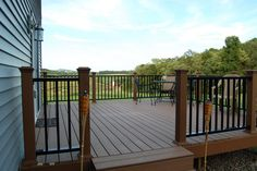 The Trex Deck my hubby installed, with the awesome, powder coated steel railing he designed/built & installed!   Since this photo, we added railing to the stairs.