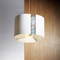 A London Underground edition of Blue Marmalade's Cog Intimo lampshade. This contemporary white pendant lampshade is a simple yet sophisticated shade with a sleek and elegant appearance. The design incorporates a glimpse of the iconic London Underground map within it's folds. Supplied flat packed this white shade is simple to put together. It can be used with either standard UK or European fittings. It can be used with either standard UK or European fittings.