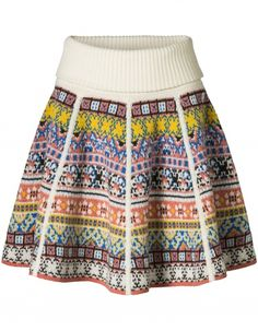 Multifunctional jacquard knitted skirt of high quality lambswool. Extra special is the fact that this skirt can be worn on two sides, and that it can additionally be worn as a poncho sweater.