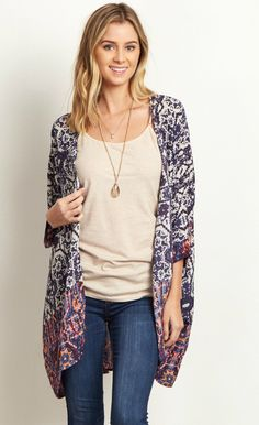 This lightweight kimono is the perfect layering piece this year. A stylish abstract print goes beautifully with a solid cami, jeans, and a chic pair of boots. A kimono like this is the perfect cover-up essential for warm days at the beach or over a maxi dress.