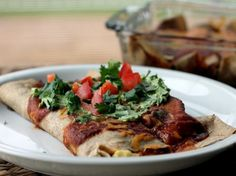 These delicious Breakfast Enchiladas are perfect for a hungry breakfast table. You'll the love the addicting enchilada sauce and fresh ingredients!