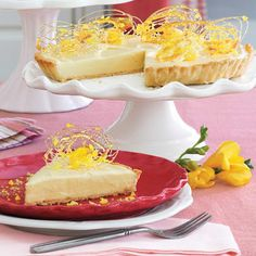 Lemon Velvet Tart.. Ingredients :  1/2 (15-oz.) package refrigerated piecrusts 2 (4-oz.) white chocolate bars, chopped 1 (8-oz.) package cream cheese, softened $ Lemon Curd 8 lemon candies Caramelized Sugar Spirals