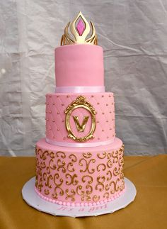 Made this princess baby shower cake with a gold sugar paste crown, gold sugar peals and gold scrolls.