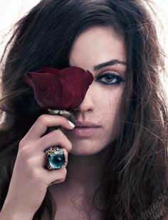 Mila Kunis - check out the ring, big blue and beautiful.