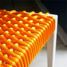 Cover a chair with Paracord! This would be great for a broken patio chair.