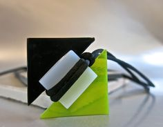 Modern, sleek, hand-made fused glass necklace for those who like geometric design.  Light green and black triangles and white square were fused together