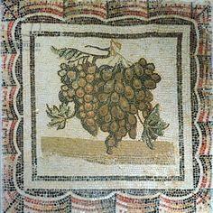 Bunch of white grapes, Roman mosaic (mosaic). Roman / Musee du Bardo, Tunis, Tunisia / The Bridgeman Art Library
