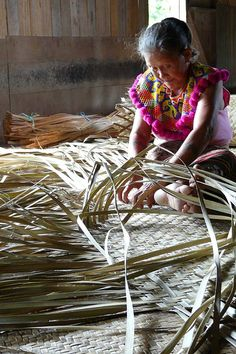 Iban tribe lady weaving a mat in Lemanak, Sarawak, Malaysia