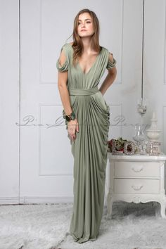 The Darla features a deep-V neckline, draping on the sleeves, a wide belt, and a… Wedding Bridesmaids, Bridesmaid Dresses, Wedding In The Woods, Every Girl, Shades Of Green, Wrap Dress, Model, How To Wear, Draping