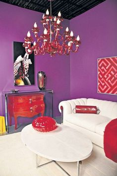 bold purple walls brilliant red and italian design enliven the living room designed by leslie - Red And Purple Living Room