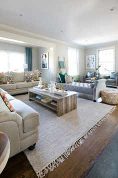 A family room makeover that is relaxed yet chic, including a family friendly rug constructed of flat weave cotton in shades of beige and grey.