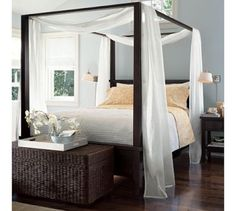 Love the four post bed with canopy and wall color...would be great for master bedroom.