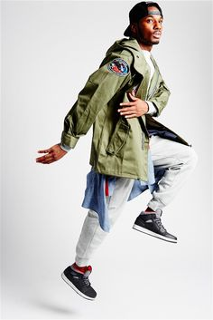 Vintage army jacket with NASA patches - stylist's own Long sleeve - Air Jordan   Grey fleece pants - Air Jordan Chambray button up - Play Cloths Holiday Lifestyle Pack sneakers - Air Jordan  Snapback - ABKLYN