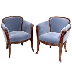 """A French Art Nouveau carved wood """"Aubépines"""" (hawthorn) pattern arm chairs by, Louis Majorelle, decorated with finely carved legs and arms.  circa 1900"""