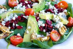 #4 on our menu! Available everyday: Baby Spinach with Avocado & Crumbled Blue Cheese, topped with cherry tomatoes, walnuts, dried cranberries & our homemade raspberry vinaigrette