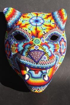 Huichol beaded jaguar head.