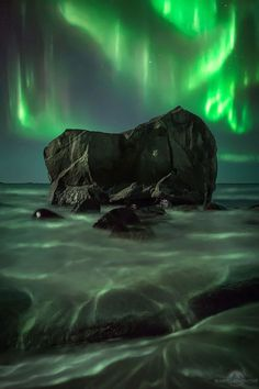 This is another shot from Uttakleiv beach, my favourite location in Lofoten Islands. That night there was a powerful aurora...and wind. What a crazy moment! After many shots I also focused attention on this big rock which looks like the top of a heart. This is of course a blending of many shots: a very long exposure to capture the details of the rock, cause was very dark, one shot for the foreground and one for the aurora.