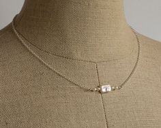Dainty white rectangular freshwater pearl with by FirepanJewellery, $44.99