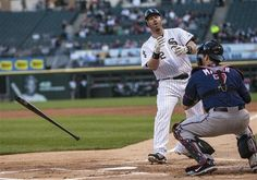 Adam Dunn tosses his bat after being called out on strikes in the first inning against the Minnesota Twins in a baseball game in Chicago on Tuesday, May 22, 2012