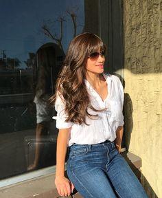 Medium brown hair with caramel highlights.