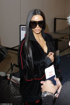 Shady lady: The KUWTK star donned humongous sunglasses and a lip ring for her jet-setting look