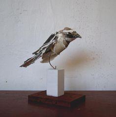 sculpted from paper pieces http://ullam.typepad.com/.a/6a00d8341c683453ef0120a7fd5e10970b-pi