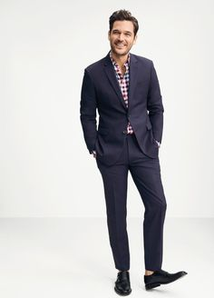 As fall approaches, do an audit of your suit wardrobe. If anything's missing, might we suggest the Slim Navy Pinstripe Wool Suit? Its slim fit modernizes the look while still remaining a classic. Our sleek suiting is fashioned from luxurious, all-season Italian wool, and fine tailoring details ensure that this is a suit you'll want to wear year after year.
