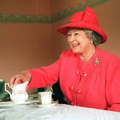 Taking tea: The Queen joined Mrs Susan McCarron for tea in her home in the Castlemilk are...