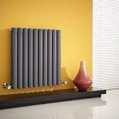 Add a pop of colour by placing your designer radiator against a bright feature wall like this. #tip