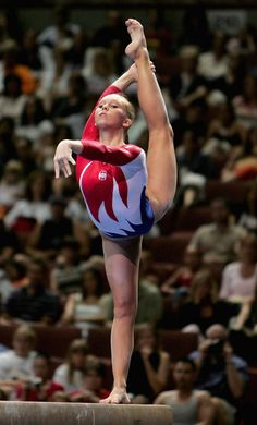 Gymnastics cheerleader can do needles in a stuct, gymnastics can do themon a 4 inch beam of wood