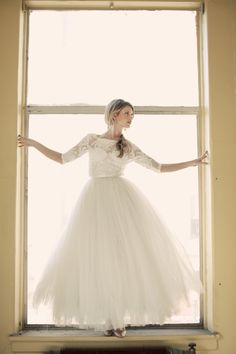 Gowns by Daci, white gown, embroidered lace sleeves and bodice, tulle skirt, ball gown cut