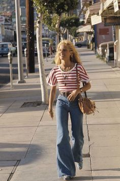 Why Singer Sylvie Vartan Is Our New French Girl Denim Inspiration In Los Angeles, 1976 mid vintage fashion day casual sports wear jeans wide leg bell bottoms sneakers red white strip top shirt found photo print girl on street 60s Fashion Trends, 70s Vintage Fashion, 70s Inspired Fashion, 60s And 70s Fashion, Fast Fashion, Vintage Outfits, Fashion Outfits, 70s Inspired Outfits, Seventies Fashion