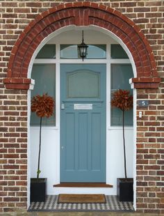 Lovely front door with arched brick entry and front porch. Teal green or blue front door. Arched Front Door, Front Door Porch, Front Door Entrance, House Front Door, Front Door Colors, Glass Front Door, Entry Doors, Garage Doors, Glass Porch