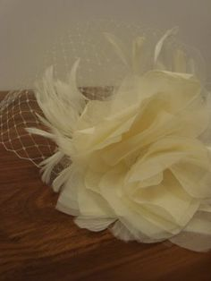 #DIY #Birdcage Veil... I'm not a fan of the shape of this veil, but the feather and flower is cute and good to know how to make.