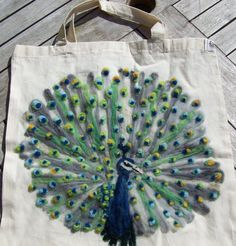 peacock felting... that's *so* awesome... I totally want one.