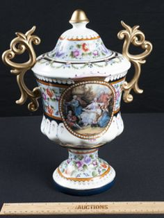 BEAUTIFUL HANDPAINTED VINTAGE LIDDED PEDESTAL URN WITH TWO HANDLES BY DRESDEN, MADE IN GERMANY. THIS COLORFUL PIECE IS REMINISCENT OF THE VICTORIAN ERA. MEASURES 14X12.