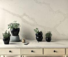 Caesarstone proudly announces their new quartz design, an interpretation of natural Calcatta marble, the elegant and cascading Calacatta Nuvo™.