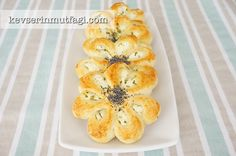 Flower Shaped Pastries - Ingredients: 2 eggs (1 egg yolk to brush on top), 3/4 cup warm milk, 3/4 cup warm water, 250 gr. butter (at room temperature), 7-8 cups flour,