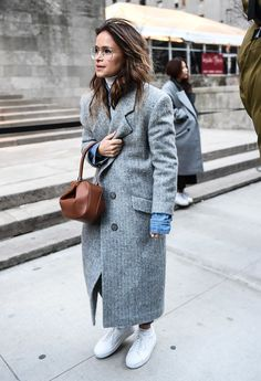 A long classic coat paired with sneakers.