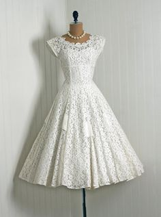 50's lace tea length wedding dress Wish it were less expensive :( Love it just the same :)
