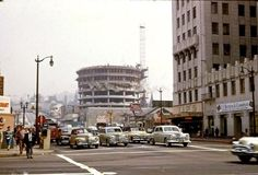 A very surreal image of Capitol Records under construction. 1955