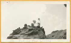 Vintage snapshot of two men sitting at the top of a rock in New Mexico. Caption reads ' Top of The World'. 1930's - For Sale -