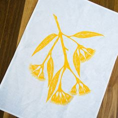 Gum Blossom Tea Towel in Yellow ink on white 100% linen.