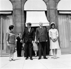 Day 1: President Charles de Gaulle and Mrs.Yvonne de Gaulle see their guests to the door after entertaining President John F. Kennedy and Jacqueline Kennedy at luncheon in their Elysee Palace residence in Paris on May 31, 1961. The midday stop climaxed a busy morning in the French capital for the U.S. Chief Executive. (AP Photo)