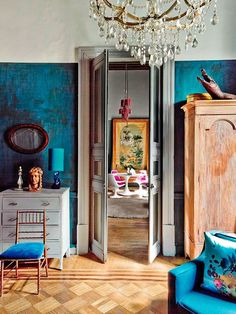 Absolutely beautiful and original home of decorator Dirk Jan Kinet - combines old Europe with the color and passion of Mexico. The hand painted walls are incredible!