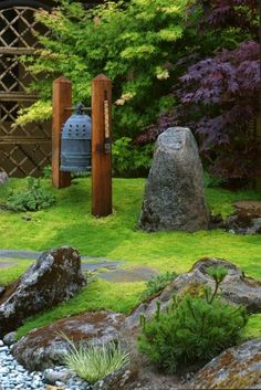 I wish this beautiful garden was mine...lovely rocks....Japanese Maple and oriental bell probably Japanese