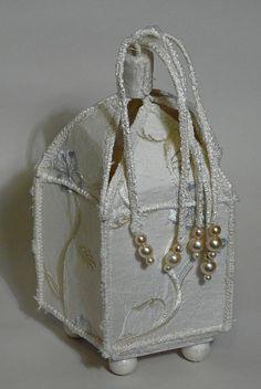 Embroidered cream silk pyx shaped box.  2006