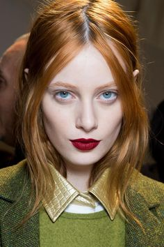 pale skin, red hair, simple eyes and dark red lips