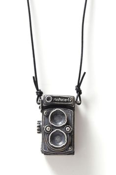 "Image of DUAL LENS.  I WANT. This is a replica of the first ""pro"" camera I used ever. I was in 10th grade. How cute that it's miniaturized into jewelry."